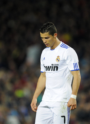 BARCELONA, SPAIN - NOVEMBER 29:  Cristiano Ronaldo of Real Madrid looks down during the La Liga match between Barcelona and Real Madrid at the Camp Nou Stadium on November 29, 2010 in Barcelona, Spain. Barcelona won the match 5-0.  (Photo by David Ramos/G