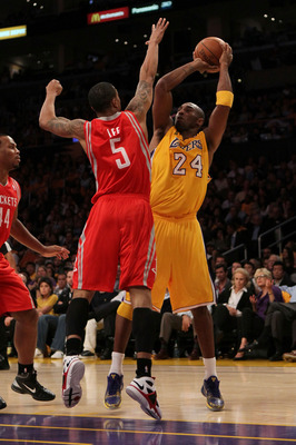 LOS ANGELES, CA - OCTOBER 26:  Kobe Bryant #24 of the Los Angeles Lakers takes a shot against Courtney Lee #5 of the Houston Rockets during their opening night game at Staples Center on October 26, 2010 in Los Angeles, California. NOTE TO USER: User expre
