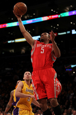 LOS ANGELES, CA - OCTOBER 26:  Courtney Lee #5 of the Houston Rockets takes a shot against the Los Angeles Lakers during their opening night game at Staples Center on October 26, 2010 in Los Angeles, California. NOTE TO USER: User expressly acknowledges a