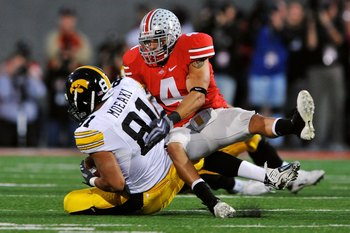 COLUMBUS, OH - NOVEMBER 14:  Safety Kurt Coleman #4 of the Ohio State Buckeyes tackles tight end Tony Moeaki #81 of the Iowa Hawkeyes at Ohio Stadium on November 14, 2009 in Columbus, Ohio.  (Photo by Jamie Sabau/Getty Images)
