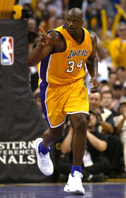 LOS ANGELES - MAY 31:  Shaquille O'Neal #34 of the Los Angeles Lakers gestures as he runs upcourt in the first half of Game 6 of the Western Conference Finals against the Minnesota Timberwolves during the 2004 NBA Playoffs on May 31, 2004 at Staples Cente