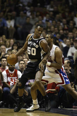 EAST RUTHERFORD, NJ - JUNE 13:  David Robinson #50 of the San Antonio Spurs is defended by Jason Collins #35 of the New Jersey Nets in game five of the 2003 NBA Finals on June 13, 2003 at the Continental Airlines Arena in East Rutherford, New Jersey.  The