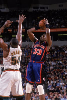 29 Mar 2000: Patrick Ewing #33 of the New York Knicks takes a shot as he is guarded by Horace Grant #54 of the Seattle SuperSonics at Key Arena in Seattle, Washington. The Knicks defeated the SuperSonics 110-95.   Mandatory Credit: Otto Greule Jr.  /Allsp