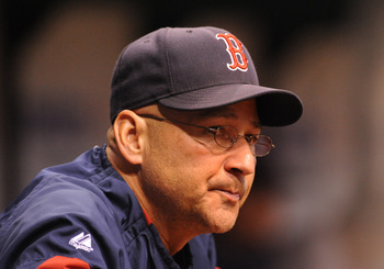 ST. PETERSBURG, FL - APRIL 30: Mananger Terry Francona #47 of the Boston Red Sox watches play against the Tampa Bay Rays April 30, 2009 at Tropicana Field in St. Petersburg, Florida.  (Photo by Al Messerschmidt/Getty Images)
