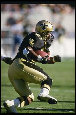 18 Oct 1992: Running back Dalton Hilliard of the New Orleans Saints moves the ball during a game against the Phoenix Cardinals at Sun Devil Stadium in Tempe, Arizona. The Saints won the game, 30-21.