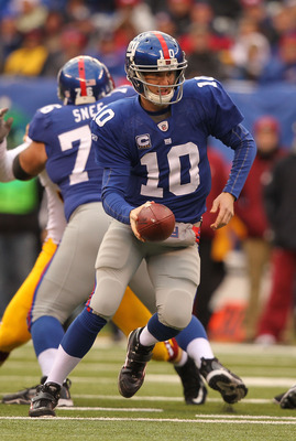 EAST RUTHERFORD, NJ - DECEMBER 05:  Eli Manning #10 of the New York Giants in action against the Washington Redskins during their game on December 5, 2010 at The New Meadowlands Stadium in East Rutherford, New Jersey.  (Photo by Al Bello/Getty Images)