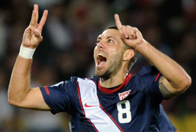 RUSTENBURG, SOUTH AFRICA - JUNE 12: Clint Dempsey of the United States celebrates his goal during the 2010 FIFA World Cup South Africa Group C match between England and USA at the Royal Bafokeng Stadium on June 12, 2010 in Rustenburg, South Africa. (Photo