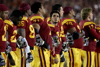 PASADENA, CA - JANUARY 04:  Kicker Mario Danelo #19, center, of the USC Trojans looks to the stands during the national anthem before the start of the BCS National Championship Rose Bowl Game between the Trojans and the Texas Longhorns at the Rose Bowl on