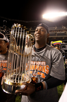 ARLINGTON, TX - NOVEMBER 01:  World Series MVP Edgar Renteria #16 of the San Francisco Giants celebrates on the field with the World Series Championship trophy after the Giants won 3-1 against the Texas Rangers in Game Five of the 2010 MLB World Series at