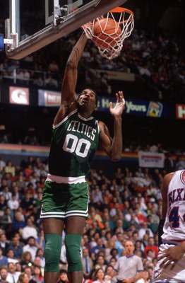 1990:  Center Robert Parish #00 of the Boston Celtics focuses on the rim as he leaps for a slam dunk during a Celtics game against the Philadelphia 76ers at the Spectrum in Philadelphia, Pennsylvania.   Mandatory Credit: Allsport USA/ALLSPORT