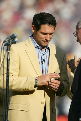 SAN FRANCISCO - NOVEMBER 20: Steve Young puts on the Hall of Fame ring as the 49ers celebrate his induction into the Hall of Fame at halftime during the NFL game between the San Francisco 49ers and the Seattle Seahawks on November 20, 2005 at Monster Park