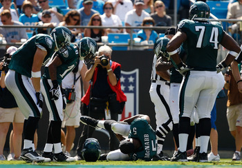 CHARLOTTE, NC - SEPTEMBER 13:  Quarterback Donovan McNabb #5 of the Philadelphia Eagles lays on the ground after injuring his knee in the second half of their NFL season opener against the Carolina Panthers at Bank of America Stadium on September 13, 2009