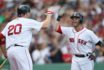 BOSTON - SEPTEMBER 13:  Dustin Pedroia #15 of the Boston Red Sox is congratulated by Kevin Youkils #20 after Pedroia hit a two run home run in the eighth inning against the Tampa Bay Rays on September 13, 2009 at Fenway Park in Boston, Massachusetts.  (Ph