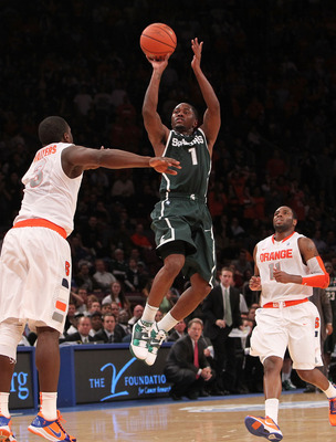 NEW YORK, NY - DECEMBER 07: Kalin Lucas #1  of the Michigan Spartans shoots a three pointer against Syracuse Orange during their game at the Jimmy V Classic at Madison Square Garden on December 7, 2010 in New York City.  (Photo by Nick Laham/Getty Images)