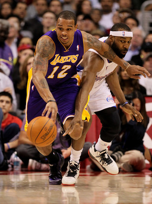 LOS ANGELES, CA - DECEMBER 8:  Shannon Brown #12 of the Los Angeles Lakers is fouled by Baron Davis #5 of the Los Angeles Clippers as he starts a break at Staples Center on December 8, 2010 in Los Angeles, California.  NOTE TO USER: User expressly acknowl