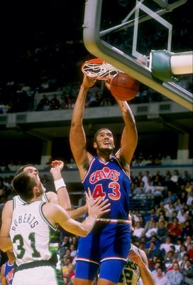 Center Brad Daugherty of the Cleveland Cavaliers sinks the ball during a game.