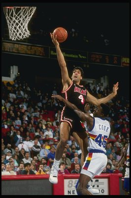 1989:  Center Rony Seikaly of the Miami Heat (left)goes up for the layup past against forward Anthony Cook of the Denver Nuggets during a game at the McNichols Arena in Denver, Colorado. Mandatory Credit: Tim de Frisco  /Allsport