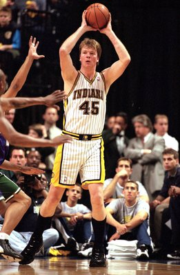 4 May 2000:  Rik Smits #45 of the Indiana Pacers puts the ball in play during the NBA Eastern Conference Playoffs Round One Game against the Milwaukee Bucks at the Conseco Field House In Indianapolis, Indiana. The Pacers defeated the Bucks 96-95.  NOTE TO