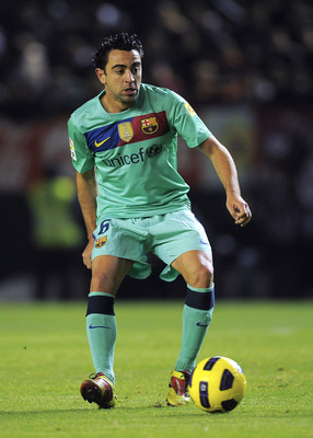PAMPLONA, SPAIN - DECEMBER 04:  Xavi Hernandez of FC Barcelona goes for the ball during the La Liga match between CA Osasuna and Barcelona at Estadio Reyno de Navarra on December 4, 2010 in Pamplona, Spain. Barcelona won 0-3.  (Photo by David Ramos/Getty