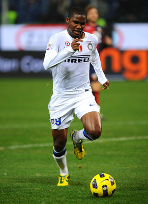 GENOA, ITALY - OCTOBER 29: Samuel Eto'o Fils of FC Internazionale Milano runs with the ball during the Serie A match between Genoa CFC and FC Inter Milan at Stadio Luigi Ferraris on October 29, 2010 in Genoa, Italy. (Photo by Massimo Cebrelli/Getty Images