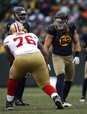 GREEN BAY, WI - DECEMBER 05: Clay Matthews #52 of the Green Bay Packers prepares to rush against Anthony Davis #76 of the San Francisco 49ers at Lambeau Field on December 5, 2010 in Green Bay, Wisconsin. The Packers defeated the 49ers 34-16.  (Photo by Jo