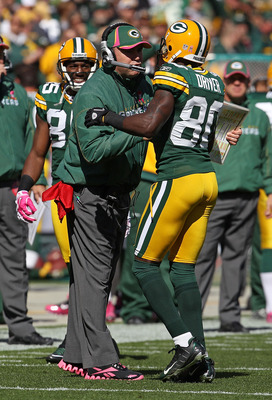 GREEN BAY, WI - OCTOBER 03: Head coach Mike McCarthy of the Green Bay Packers congratulates Donald Driver #80 after a touchdown against the Detroit Lions at Lambeau Field on October 3, 2010 in Green Bay, Wisconsin. The Packers defeated the Lions 28-26. (P