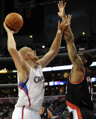 LOS ANGELES, CA - OCTOBER 27:  Chris Kaman #35 of the Los Angeles Clippers shoots a jump hook over LaMarcus Aldridge #12 of the Portland Trail Blazers at Staples Center on October 27, 2010 in Los Angeles, California. NOTE TO USER: User expressly acknowled