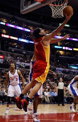 LOS ANGELES, CA - DECEMBER 02:  Luis Scola #4 of the Houston Rockets goes up for a reverse layup against the Los Angeles Clippers in the first half at Staples Center on December 2, 2009 in Los Angeles, California. The Rockets defeated the Clippers 102-85.