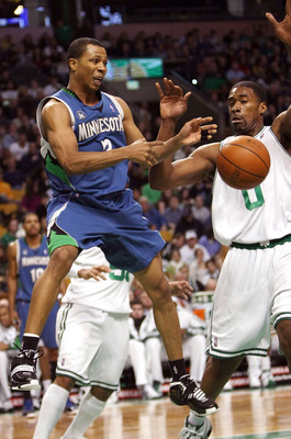 BOSTON - FEBRUARY 01:  Sebastian Telfair #3 of Minnesota Timberwolves passes the ball as Leon Powe #0 of the Boston Celtics defends on February 1, 2009 at TD Banknorth Garden in Boston, Massachusetts. NOTE TO USER: User expressly acknowledges and agrees t