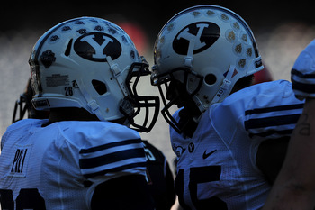 SAN DIEGO - OCTOBER 17:  Max Hall #15 and Jo Jo Pili #26 of BYU Cougars celebrate a touchdown against San Diego State Aztecs at Qualcomm Stadium on October 17, 2009 in San Diego, California.  (Photo by Jacob de Golish/Getty Images)