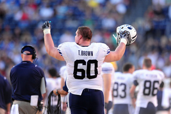 SAN DIEGO - OCTOBER 17: Terrence Brown #60 of BYU Cougars reacts to a great play against  San Diego State Aztecs at Qualcomm Stadium on October 17, 2009 in San Diego, California.  (Photo by Jacob de Golish/Getty Images)