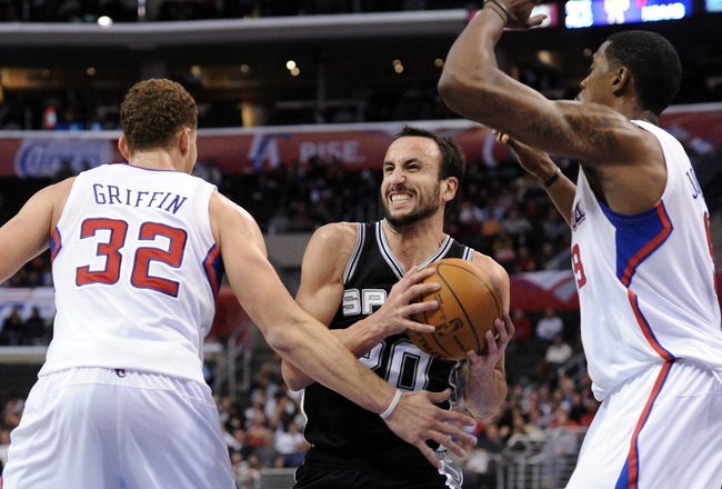LOS ANGELES, CA - DECEMBER 01:  Manu Ginobili #20 of the San Antonio Spurs cuts between Blake Griffin #32 and DeAndre Jordan #9 of the Los Angeles Clippers during the game at the Staples Center on December 1, 2010 in Los Angeles, California.  NOTE TO USER