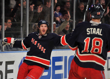 NEW YORK, NY - DECEMBER 5: Brandon Prust #8 of the New York Rangers celebrates scoring a second period goal with Marc Staal #18 of the New York Rangers during the second period against the Ottawa Senators at Madison Square Garden on December 5, 2010 in Ne