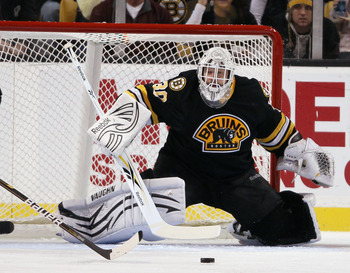 BOSTON - NOVEMBER 26:  Tim Thomas #30 of the Boston Bruins stops a shot in the first period against the Carolina Hurricanes on November 26, 2010 at the TD Garden in Boston, Massachusetts.  (Photo by Elsa/Getty Images)