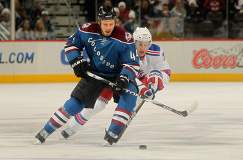 DENVER - NOVEMBER 19:  Ryan Wilson #44 of the Colorado Avalanche tries to control the puck while under pressure from Derek Stepan #21 of the New York Rangers at the Pepsi Center on November 19, 2010 in Denver, Colorado.  (Photo by Doug Pensinger/Getty Ima