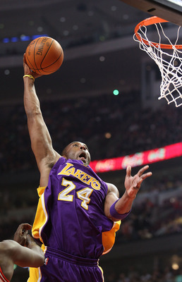 CHICAGO, IL - DECEMBER 10: Kobe Bryant #24 of the Los Angeles Lakers goes up for a dunk against the Chicago Bulls at the United Center on December 10, 2010 in Chicago, Illinois. NOTE TO USER: User expressly acknowledges and agrees that, by downloading and