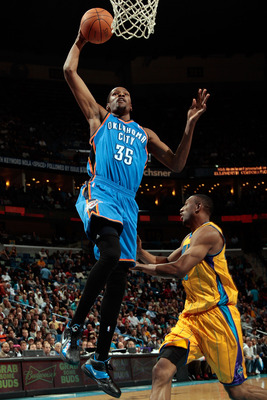 NEW ORLEANS, LA - DECEMBER 10:  Kevin Durant #35 of the Oklahoma City Thunder dunks the ball over D.J. Mbenga #28 of the New Orleans Hornets  at New Orleans Arena on December 10, 2010 in New Orleans, Louisiana.    The Thunder defeated the Hornets 97-92.