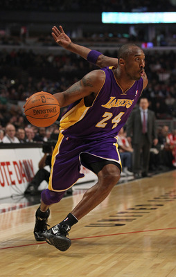 CHICAGO, IL - DECEMBER 10: Kobe Bryant #24 of the Los Angeles Lakers drives against the Chicago Bulls at the United Center on December 10, 2010 in Chicago, Illinois. The Bulls defeated the Lakers 88-84. NOTE TO USER: User expressly acknowledges and agrees