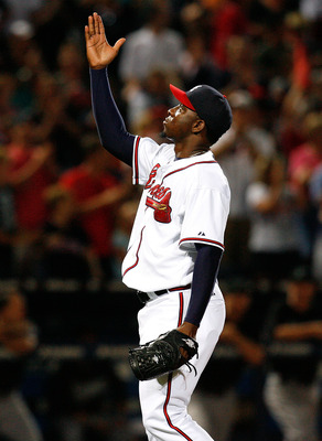ATLANTA - AUGUST 22:  Closing pitcher Rafael Soriano #39 of the Atlanta Braves celebrates after defeating the Florida Marlins 4-3 on August 22, 2009 at Turner Field in Atlanta, Georgia.  (Photo by Kevin C. Cox/Getty Images)