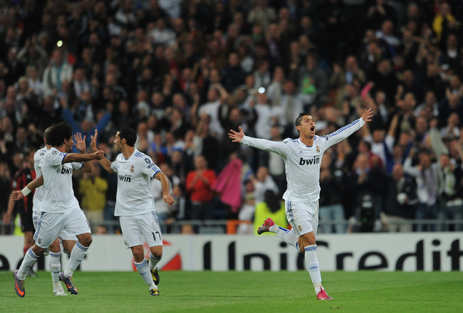 MADRID, SPAIN - OCTOBER 19:  Cristiano Ronaldo of Real Madrid celebrates scoring his sides opening goal from a free kick during the UEFA Champions League group G match between Real Madrid and AC Milan at the Estadio Santiago Bernabeu on October 19, 2010 i