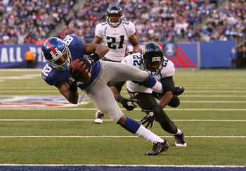 EAST RUTHERFORD, NJ - NOVEMBER 28:  Mario Manningham #82 of the New York Giants scores a touchdown in the fourth Quarter as Don Carey #22 of the Jacksonville Jaguars misses the tackle during their game on November 28, 2010 at The New Meadowlands Stadium i
