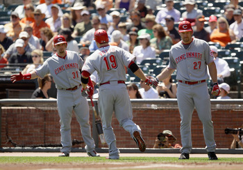 SAN FRANCISCO - AUGUST 25:  Joey Votto #19 of the Cincinnati Reds is congratulated by Scott Rolen #27 and Jonny Gomes #31 after Votto hit a home run in the first inning of their game against the San Francisco Giants at AT&T Park on August 25, 2010 in San