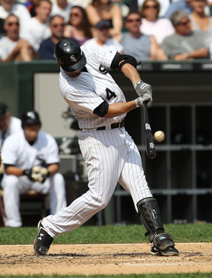 CHICAGO - AUGUST 29: Paul Konerko #14 of the Chicago White Sox hits the ball against the New York Yankees at U.S. Cellular Field on August 29, 2010 in Chicago, Illinois. The Yankees defeated the White Sox 2-1. (Photo by Jonathan Daniel/Getty Images)
