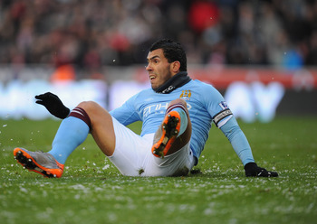 STOKE ON TRENT, ENGLAND - NOVEMBER 27:   Carlos Tevez of Manchester City in action during the Barclays Premier League match between Stoke City and Manchester City at Britannia Stadium on November 27, 2010 in Stoke on Trent, England.  (Photo by Clive Mason