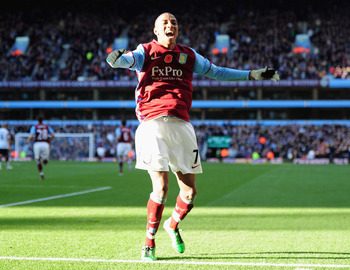 BIRMINGHAM, ENGLAND - NOVEMBER 13:  Ashley Young of Aston Villa celebrates after scoring the opening goal during the Barclays Premier League match between Aston Villa and Manchester United at Villa Park on November 13, 2010 in Birmingham, England.  (Photo