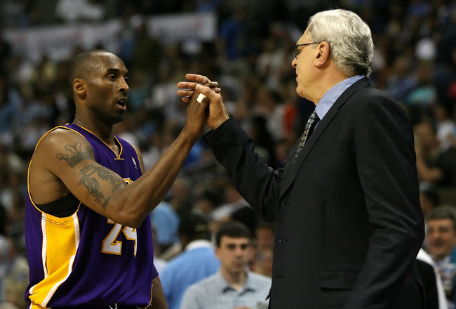 DENVER - MAY 29:  (L-R) Kobe Bryant #24 of the Los Angeles Lakers shakes hands with head coach Phil Jackson as Bryant is taken out of the game in the fourth quarter against the Denver Nuggets in Game Six of the Western Conference Finals during the 2009 NB
