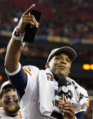 ATLANTA, GA - DECEMBER 04:  Quarterback Cam Newton #2 of the Auburn Tigers celebrates after winning the MVP trophy in their 56-17 win over the South Carolina Gamecocks during the 2010 SEC Championship at Georgia Dome on December 4, 2010 in Atlanta, Georgi
