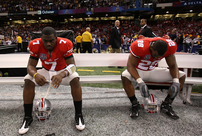 NEW ORLEANS - JANUARY 07:  Antonio Henton #7 and Chris Wells #28 of the Ohio State Buckeyes sit dejected after losing 38-24 to the Louisiana State University Tigers during the AllState BCS National Championship on January 7, 2008 at the Louisiana Superdom