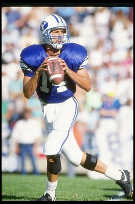 22 Sep 1990:  Quarterback Ty Detmer of the Brigham Young Cougars drops back to pass during a game against the San Diego State Aztecs at Cougar Stadium in Provo, Utah.  Brigham Young won the game 62-34. Mandatory Credit: Mike Powell  /Allsport