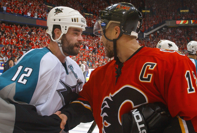 CALGARY, ALBERTA - MAY 19:  Patrick Marleau #12 of the San Jose Sharks congratulates Jarome Iginla #12 of the Calgary Flames after Game six of the 2004 NHL Western Conference Finals on May 19, 2004 at the Pengrowth Saddledome in Calgary, Alberta. The Flam